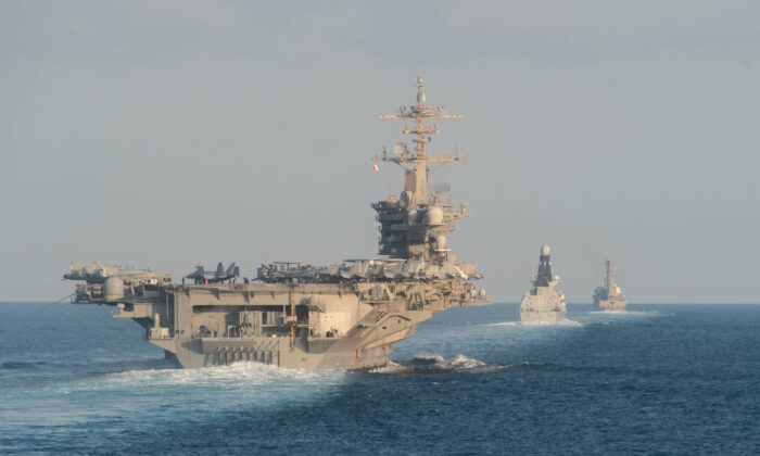 In this handout photo provided by the US Navy, The aircraft carrier USS Abraham Lincoln (CVN 72), left, the Royal Navy air defense destroyer HMS Defender (D 36) and the guided-missile destroyer USS Farragut (DDG 99) transit the Strait of Hormuz on Nov. 19, 2019. (Zachary Pearson- U.S. Navy via Getty Images)