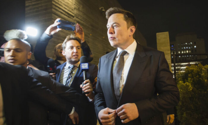Elon Musk, chief executive officer of Tesla Inc. leaves  the US District Court, Central District of California through a back door in Los Angeles, U.S. in Los Angeles, California on Dec. 3, 2019. (Apu Gomes/Getty Images)