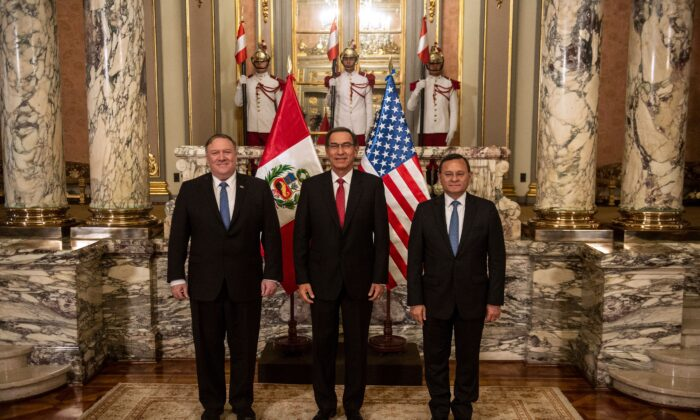 (L-R) US Secretary of State Mike Pompeo, Peru's President Martin Vizcarra and Peruvian Foreign Minister Nestor Popolisio pose for pictures at the Governement Palace in Lima, Peru on April 13, 2019. - Pompeo landed in Peru on Saturday on the third-leg of a four-nation tour of Latin American allies focusing heavily on Venezuela and countering China's economic reach. (Ernesto Benavides/AFP via Getty Images)