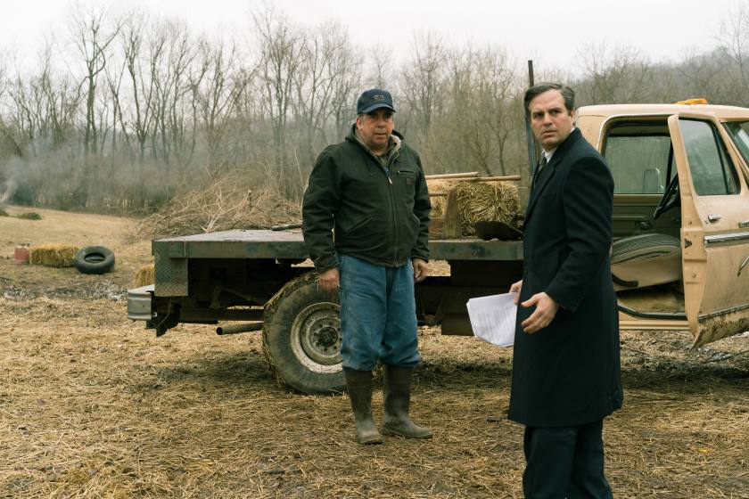 farmer and lawyer in front of a truck