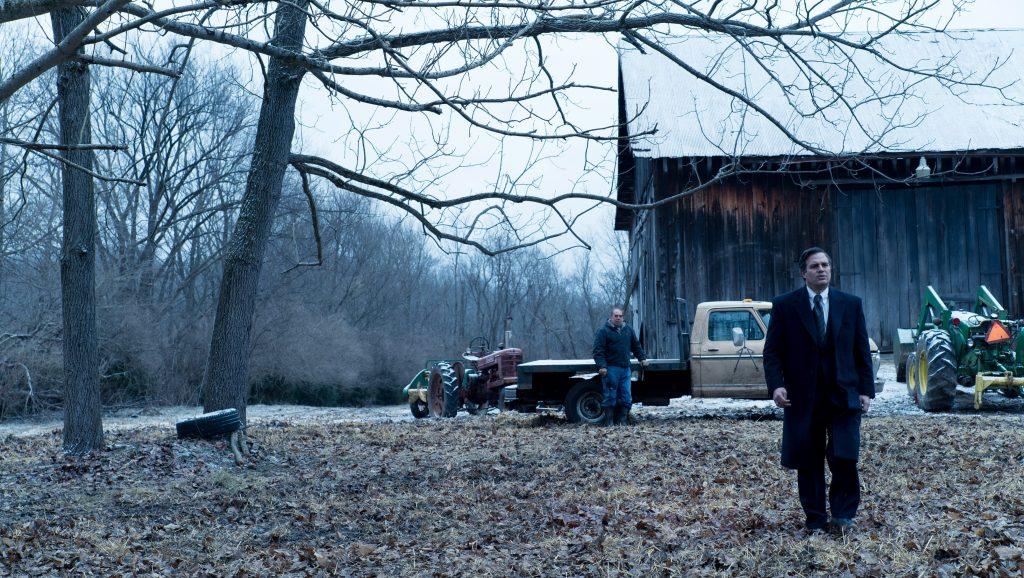 two men near barn