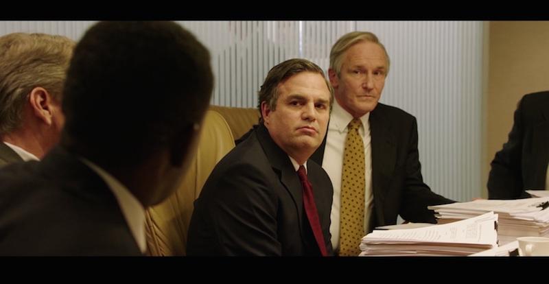 four men in a legal meeting