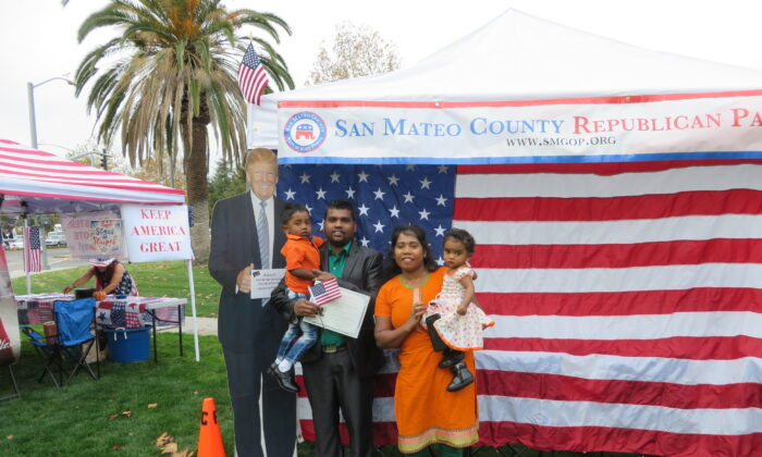 Matheeswaran Tharmarathinan and his family took a picture with Trump cutout on Nov. 26 at Naturalization Ceremony in Santa Clara County. (Nathan Su/The Epoch Times)