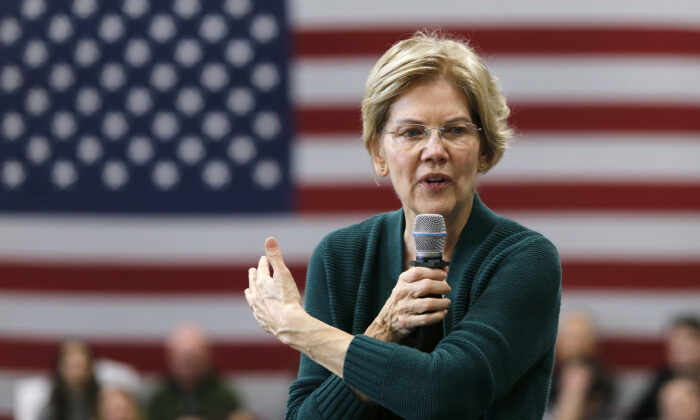 Democratic presidential candidate Sen. Elizabeth Warren (D-Mass.) gestures as she speaks during a campaign stop in Manchester, N.H. on Nov. 23, 2019. (Mary Schwalm/AP Photo)