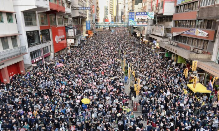 Tens of thousands of protesters march in the streets in Causeway Bay in Hong Kong on Dec. 8, 2019. (Sung Bi-lung/The Epoch Times)