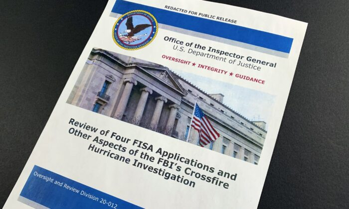 The cover page of the report issued by the Department of Justice inspector general is photographed in Washington, on Dec. 9, 2019. (Jon Elswick/AP Photo)