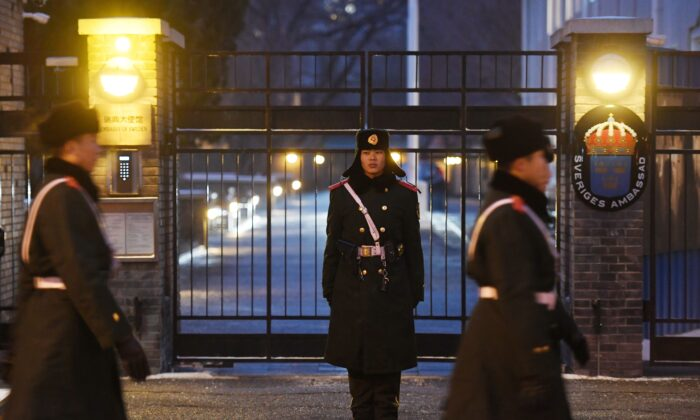 Paramilitary police officers patrol outside the Swedish embassy in Beijing on Feb. 14, 2019. - Sweden's ambassador to Beijing has been recalled to Stockholm after claims she brokered an unauthorized meeting over the fate of detained Chinese-Swedish bookseller Gui Minhai, the Swedish foreign ministry said on Feb. 14. (Greg Baker/AFP via Getty Images)
