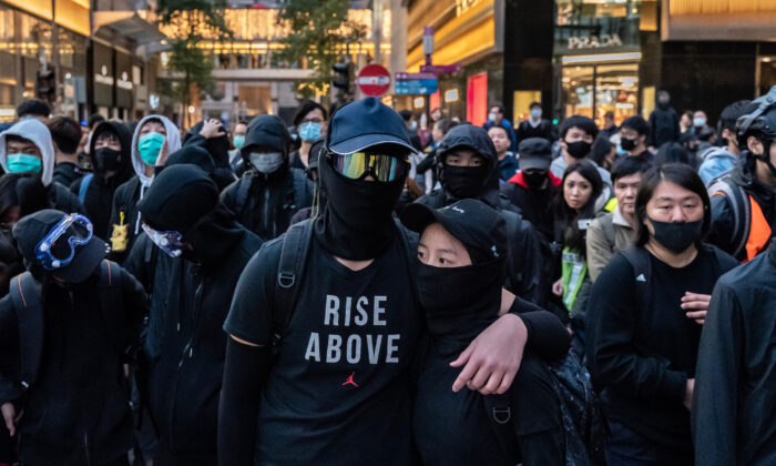 Protesters form a frontline during a standoff with police at a demonstration in Hong Kong on December 8, 2019. (Anthony Kwan/Getty Images)