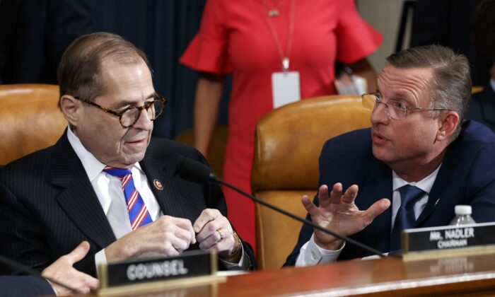 House Judiciary Committee Chairman Rep. Jerrold Nadler (D-N.Y.) (L), listens to ranking member Rep. Doug Collins (R-Ga.) after the House Judiciary Committee hearing on the constitutional grounds for the impeachment of President Donald Trump on Capitol Hill in Washington on Dec. 4, 2019. (Alex Brandon/AP Photo)