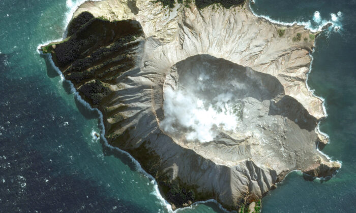 White Island in New Zealand before a volcano erupted on Monday, Dec. 9. (Satellite image May 12, 2019, Maxar Technologies via AP)
