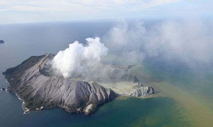 This aerial photo shows White Island after its volcanic eruption in New Zealand on Dec. 9, 2019. (George Novak/New Zealand Herald via AP)