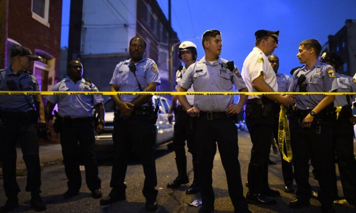 Police officers responding to a shooting in Philadelphia on Aug. 14, 2019. At least six police officers were reportedly wounded in an hours-long standoff with a gunman. (Mark Makela/Getty Images)