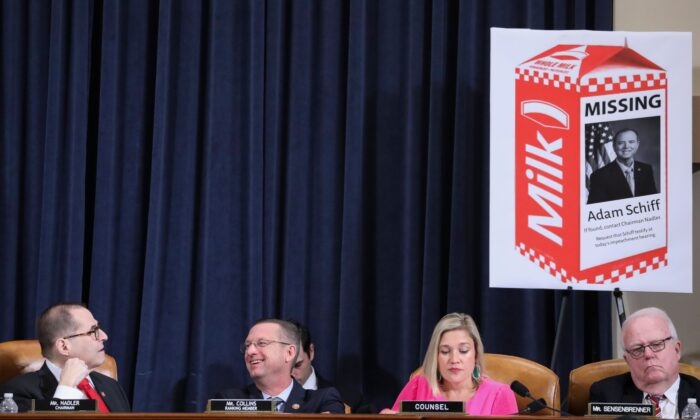 House Judiciary Chairman Rep. Jerrold Nadler (D-N.Y.) looks up at a Republican prop with an image of House Intelligence Committee Chairman Adam Schiff (D-Calif.) on a milk carton as ranking member Rep. Doug Collins (R-Ga.) laughs while sitting beside Republican staff counsel Ashley Hurt Callen and Rep. Jim Sensenbrenner (R-Wis.) during a House Judiciary Committee hearing to receive counsel presentations of evidence on the impeachment inquiry into President Donald Trump on Capitol Hill in Washington on Dec. 9, 2019. (Jonathan Ernst/Pool/AFP via Getty Images)