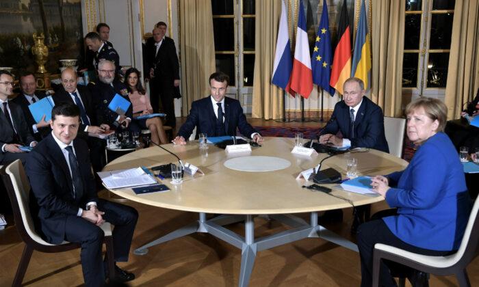 Ukrainian President Volodymyr Zelensky (L), French President Emmanuel Macron, Russian President Vladimir Putin, and German Chancellor Angela Merkel attend a Normandy-format summit in Paris, France, on Dec. 9, 2019. (Sputnik/Alexei Nikolsky/Kremlin via Reuters)