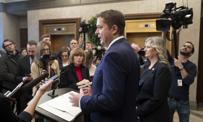 Conservative Party Leader Andrew Scheer speaks with the media in the foyer of the House of Commons as Deputy Leader Leona Alleslev looks on, on Nov. 28, 2019. (The Canadian Press/Adrian Wyld)