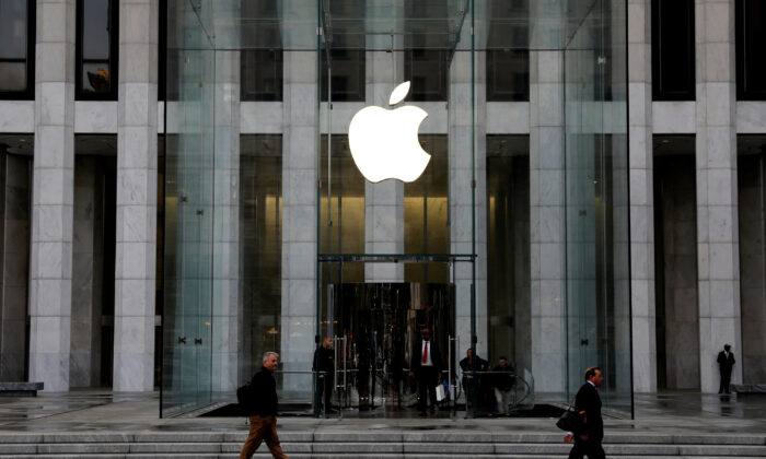 The Apple Inc. logo is seen hanging at the entrance to the Apple store on 5th Avenue in Manhattan, New York, U.S. on Oct. 16, 2019. (Mike Segar/Reuters)