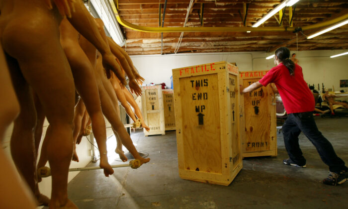 A worker ships crates of sex dolls in San Marcos, Calif., on Feb. 5, 2004. (David McNew/Getty Images)