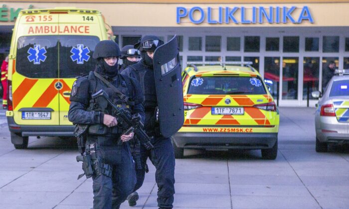 Police personnel outside the Ostrava Teaching Hospital after a shooting incident in Ostrava, Czech Republic on Dec. 10, 2019. (Vladimir Prycek/CTK via AP)