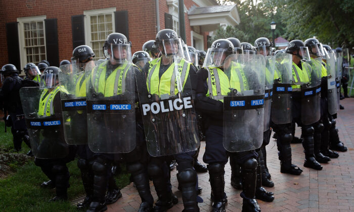 Members of the Virginia State Police stand guard in riot gear on the campus of the University of Virginia during an event in Charlottesville, Virginia on Aug. 11, 2018. (Win McNamee/Getty Images)