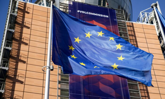 An European Union flag flies in front of the European Commission headquarters in Brussels on December 3, 2019. (ARIS OIKONOMOU/AFP via Getty Images)