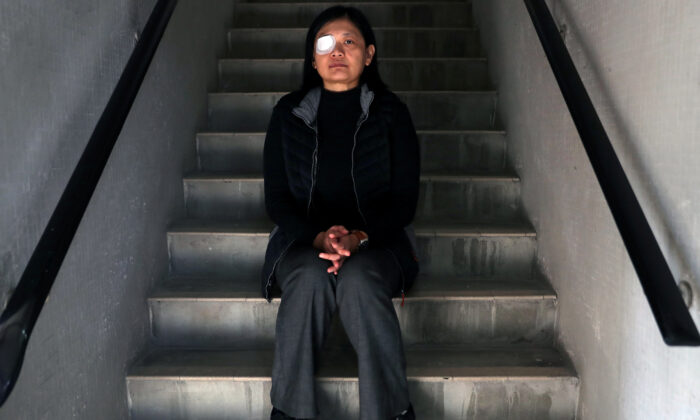 Indonesian journalist Veby Mega Indah, whose right eye was severely injured by Hong Kong police during a protest, poses for a portrait in Hong Kong, China on Dec. 4, 2019. (Leah Millis/Reuters)
