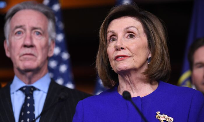 Speaker of the House Nancy Pelosi and House Ways and Means Committee Chairman Richard Neal speak about the USMCA trade deal on Dec. 10, 2019. (SAUL LOEB/AFP via Getty Images)