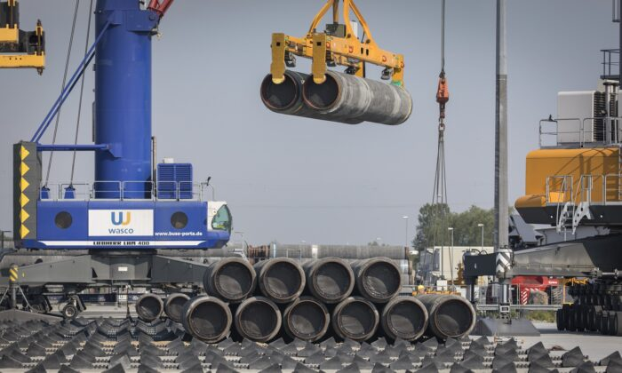 A crane moves Nord Stream 2 pipes at the Mukran port near Sassnitz, Germany, on June 5, 2019. (Axel Schmidt/Getty Images)
