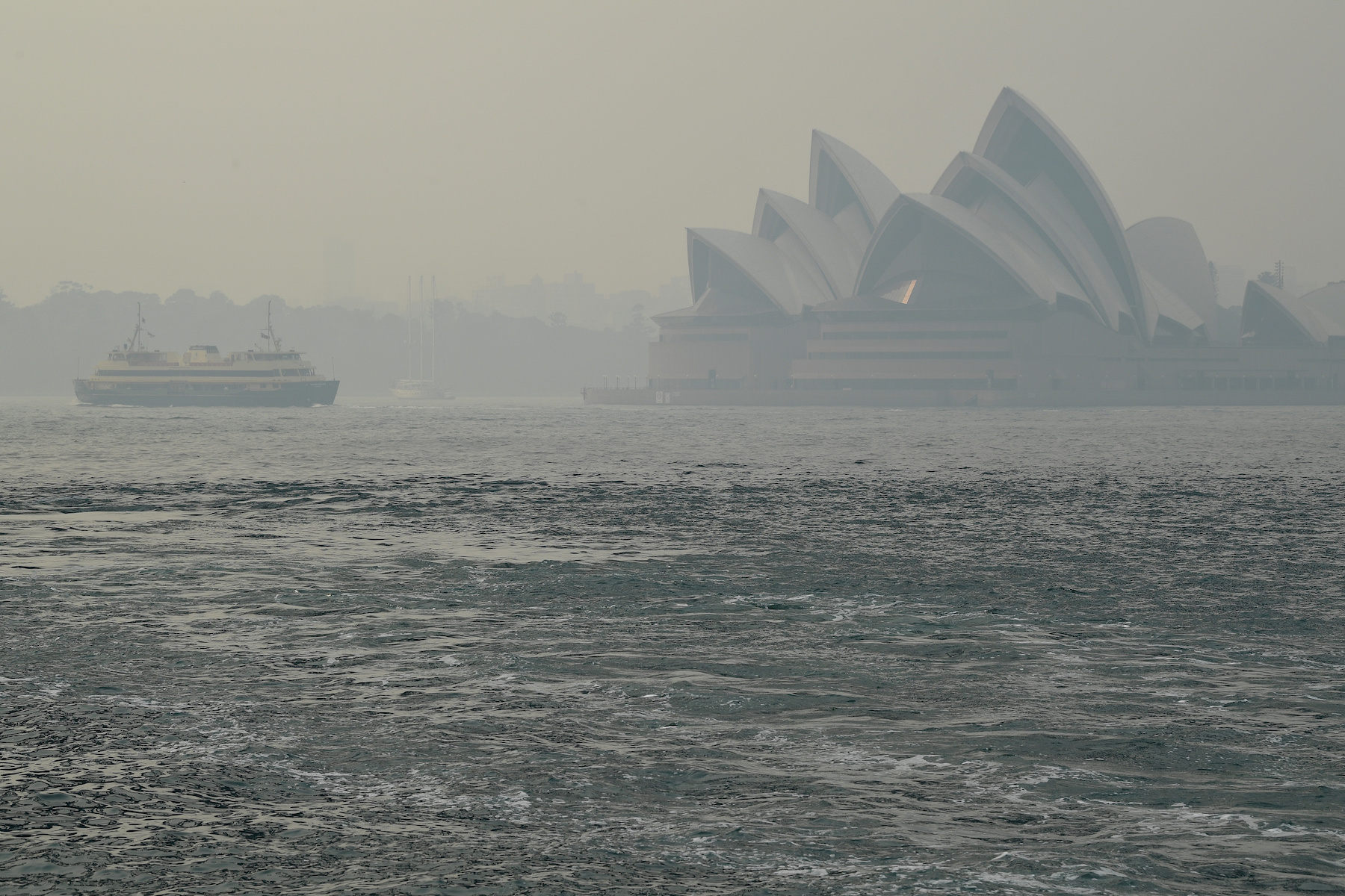 Sydney Opera House can be seen as smoke haze from bushfires in New South Wales blankets the CBD in Sydney