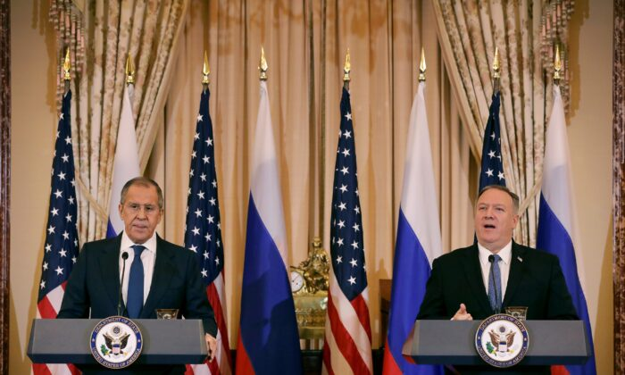 Russian Foreign Minister Sergey Lavrov, left, and U.S. Secretary of State Mike Pompeo hold a joint news conference in the Franklin Room at the State Department in Washington on Dec. 10, 2019. (Chip Somodevilla/Getty Images)