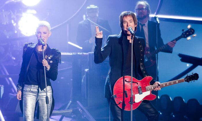 Marie Fredriksson (L) and Per Gessle (R) of Roxette perform during the 193th 'Wetten, Dass...?' show at the Messe Halle on February 12, 2011 in Halle, Germany.  (Photo by Marco Prosch/Getty Images)
