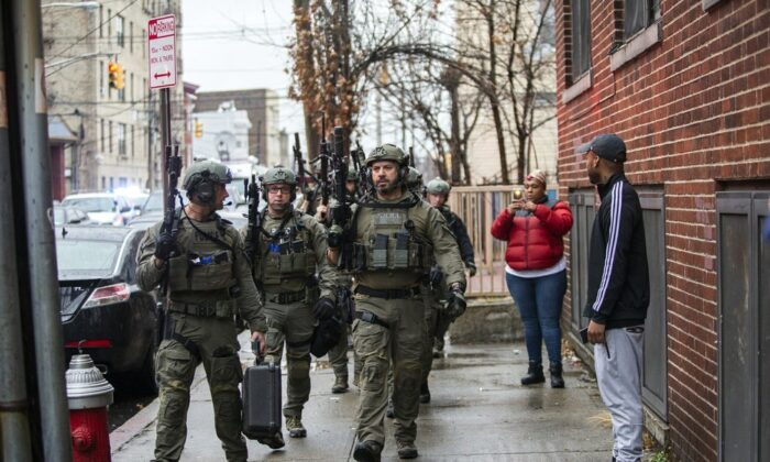 Police officers arrive at the scene following reports of gunfire, in Jersey City, N.J., on Dec. 10, 2019. (Eduardo Munoz Alvarez/AP Photo)