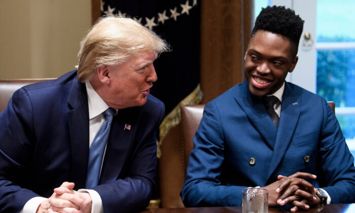 Walter Blanks listens as President Donald Trump participates in a roundtable discussion on empowering families with education choices at the White House in Washington on Dec. 9, 2019. (Brendan Smialowski/AFP via Getty Images)
