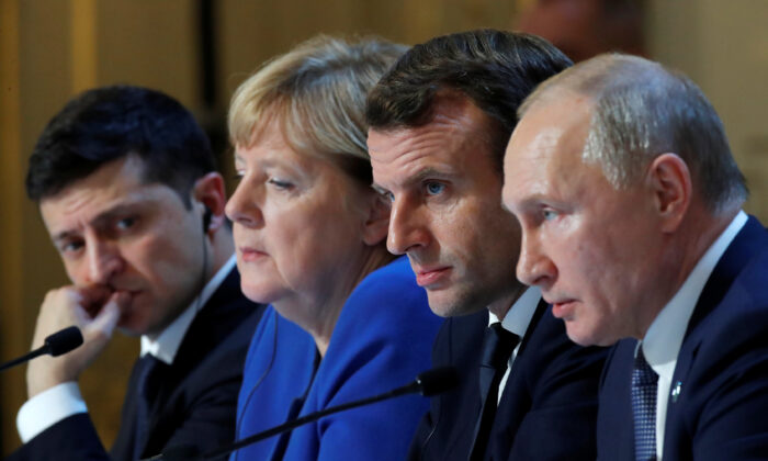 Ukraine's President Volodymyr Zelenskiy, German Chancellor Angela Merkel, French President Emmanuel Macron and  Russia's President Vladimir Putin attend a joint news conference after a Normandy-format summit in Paris, France Dec. 9, 2019. (Charles Platiau/Pool?/Reuters)