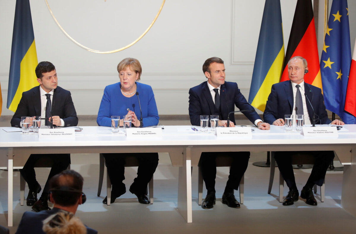 (L to R) Ukraine's President Volodymyr Zelenskiy , Germany's Chancellor Angela Merkel, France's President Emmanuel Macron and Russia's President Vladimir Putin attend a joint news conference after a Normandy-format summit in Paris, France December 9, 2019. (Charles Platiau/Pool/Reuters)