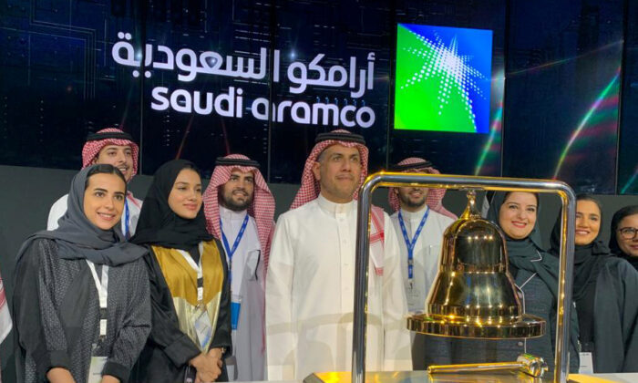 Participants attend the official ceremony marking the debut of Saudi Aramco's initial public offering (IPO) on the Riyadh's stock market, in Riyadh, Saudi Arabia, on Dec. 11, 2019. (Reuters/Marwa Rashad)