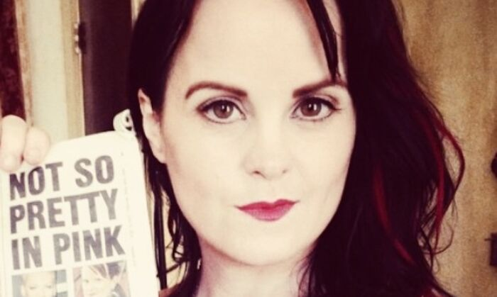 Collette McLafferty holding a copy of the New York Post newspaper at the Yellow Brick Collective in New York on Aug. 25, 2014. (Courtesy of Collette McLafferty)