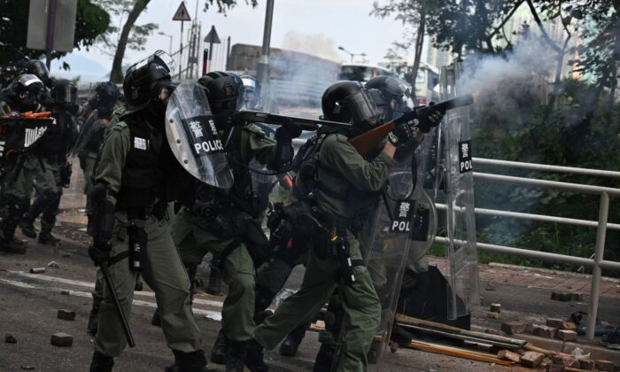 Police fire tear gas towards protesters at the Chinese University of Hong Kong (CUHK), in Hong Kong on Nov. 12, 2019. (Philip Fong/AFP via Getty Images)