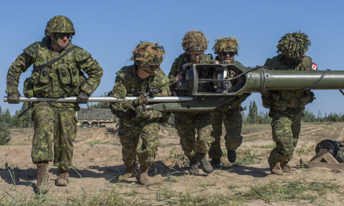 Members from the 2nd Regiment, Royal Canadian Horse Artillery unit, which is serving in NATO's Canada-led Enhanced Forward Presence Battle Group in Latvia, conduct an exercise using the M777 howitzer gun at Camp Ādaži, Latvia, on Aug. 10 2018. (eFP BG ROTO 10 LATVIA Imagery)