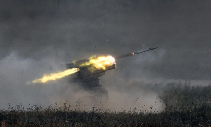 A Russian Grad multiple rocket launcher system fires in Kubinka Patriot Park outside Moscow on Aug. 22, 2017. (Alexander Nemenov/AFP via Getty Images)