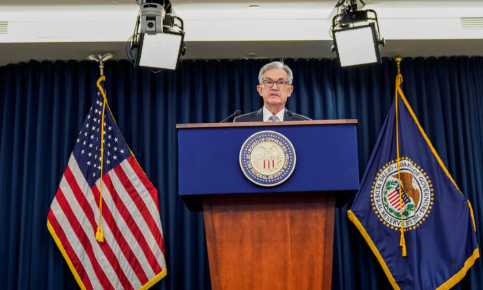 Federal Reserve Chair Jerome Powell holds a news conference following the Federal Open Market Committee meeting in Washington, on Dec. 11, 2019. (Joshua Roberts/Reuters)