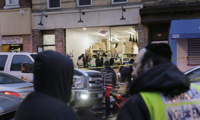 Emergency responders work at a kosher supermarket, the site of a shooting in Jersey City, N.J. on Dec. 11, 2019. (Seth Wenig/AP Photo)