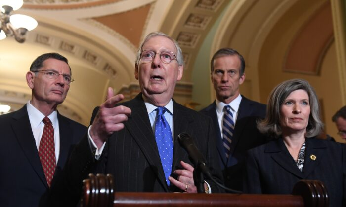 Senate Majority Leader Mitch McConnell (R-Ky.) speaks during a press conference as Sen. John Barrasso (R-Wyo.), left, Sen. John Thune (R-S.D.), second from right, and Sen. Joni Ernst (R-Iowa), listen, at the U.S. Capitol in Washington on Dec. 10, 2019. (Saul Loeb/AFP via Getty Images)