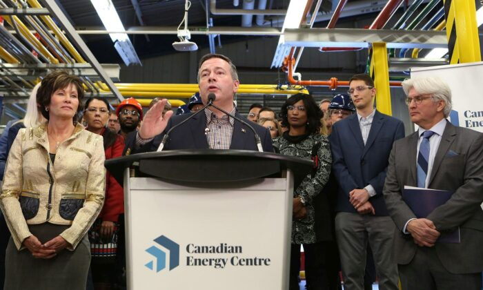 Alberta Premier Jason Kenney announces the launch of the Canadian Energy Centre at SAIT in Calgary on Dec. 11, 2019. Looking on are Energy Minister Sonya Savage (L) and Tom Olsen, managing director of the Energy Centre. (The Canadian Press/Greg Fulmes)