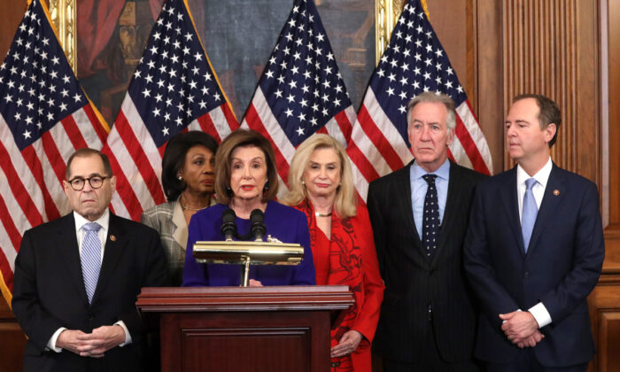 Speaker of the House Rep. Nancy Pelosi (D-Calif.) (C) speaks as (L-R) Chairman of House Judiciary Committee Rep. Jerry Nadler (D-N.Y.), Chairwoman of House Financial Services Committee Rep. Maxine Waters (D-Calif.), Chairwoman of House Oversight and Reform Committee Rep. Carolyn Maloney (D-N.Y.) and Chairman of House Ways and Means Committee Rep. Richard Neal (D-MA) listen during a news conference at the U.S. Capitol in Washington, DC, on Dec. 10, 2019. Chairman Nadler announced that the Judiciary Committee is introducing two articles on abuse of power and obstruction of Congress for the next steps in the House impeachment inquiry against President Trump. Alex Wong/Getty Images