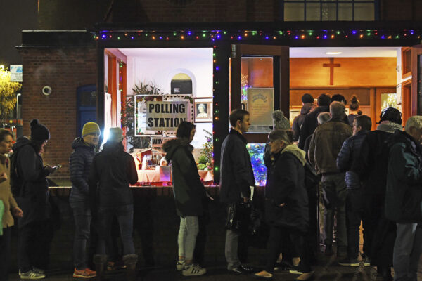 Voters queue outside St Andrews Church polling station in Balham,