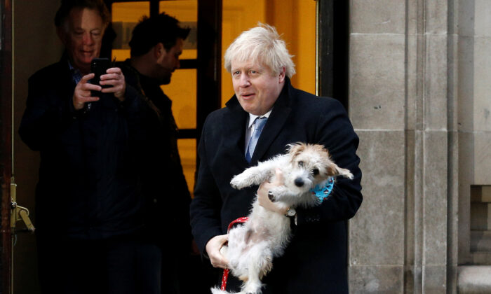 Britain's Prime Minister Boris Johnson leaves a polling station at the Methodist Central Hall, with his dog Dilyn, after voting in the general election in London, Britain, on Dec.12, 2019. (Henry Nicholls/Reuters)