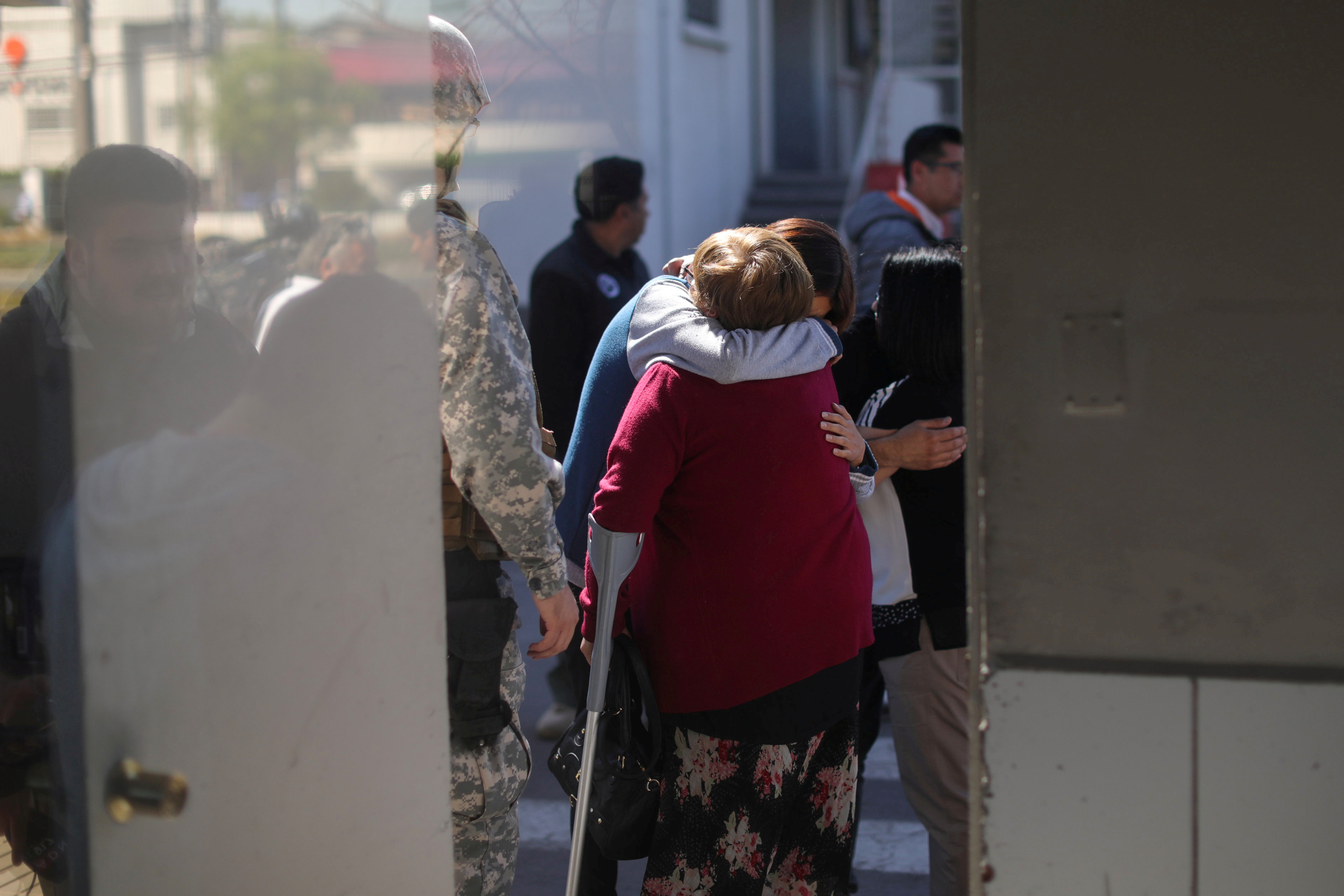 FILE PHOTO: People react inside an air force base in Santiago