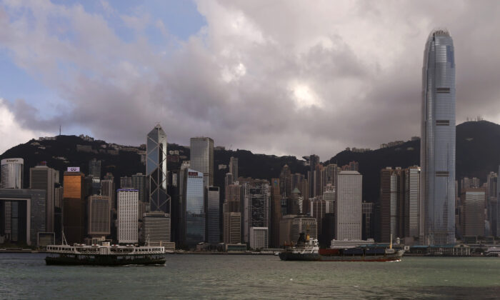 A Star Ferry sails past Hong Kong's business Central district June 18, 2014. (Bobby Yip/Reuters)