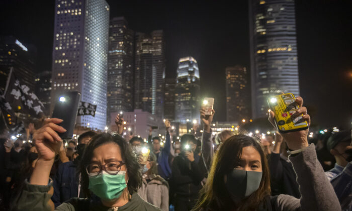 Protestors hold up their smartphone lights at a rally in Hong Kong, China on Dec. 12, 2019. (Mark Schiefelbein/AP Photo)