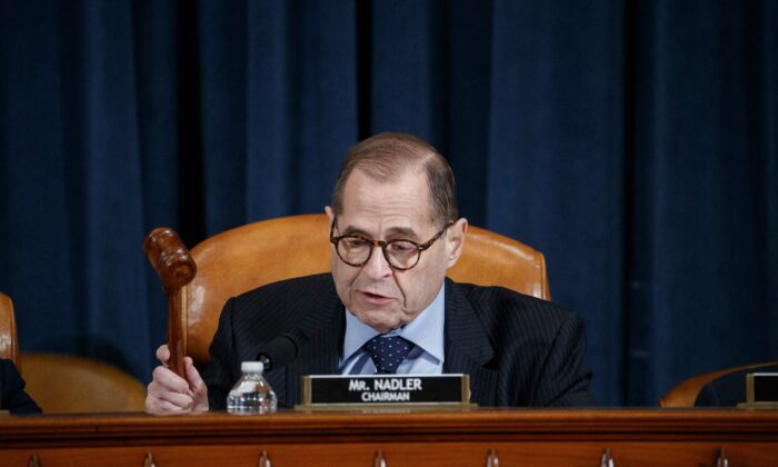 House Judiciary Chairman Jerry Nadler (D-N.Y.) gavels the House Judiciary Committee's markup of House Resolution 755, Articles of Impeachment Against President Donald Trump to recess on Capitol Hill in Washington on Dec. 11, 2019. (Shawn Thew/POOL/AFP via Getty Images)